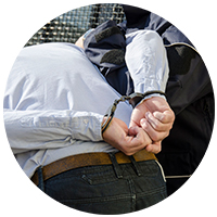 Photo of man being arrested by police officer